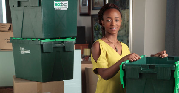 woman with reusable moving boxes